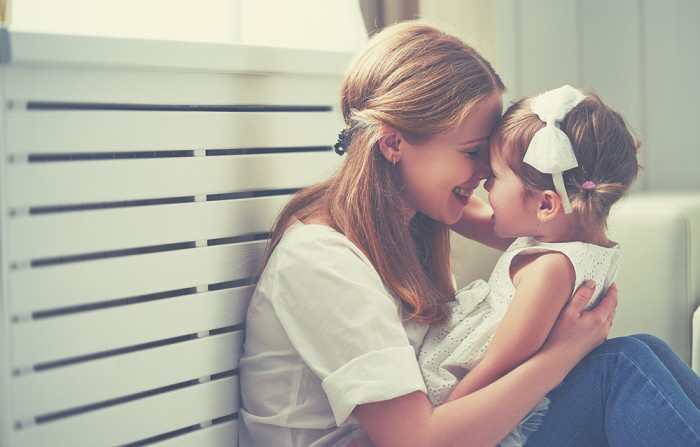 Happy loving family. mother and child girl playing kissing and hugging