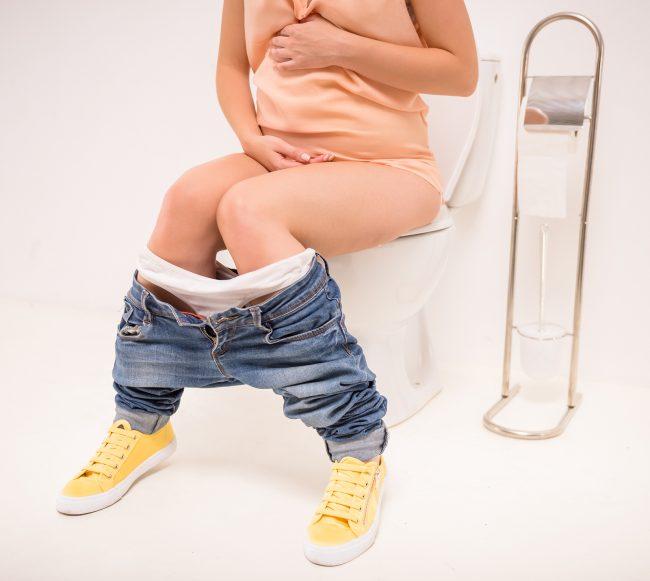 vrouw In Toilet zwangertest